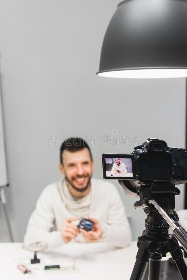 Video tutorial creation filming backstage concept. Videoblogger lifestyle. demonstration and advertising of microcomputer royalty free stock photography