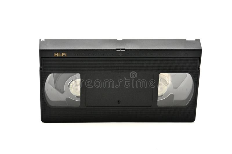 Videoband f?r hem- bruk p? en vit bakgrund videocassette arkivbild