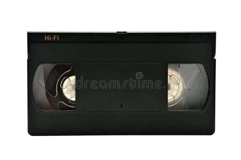 Videoband f?r hem- bruk p? en vit bakgrund videocassette royaltyfri bild