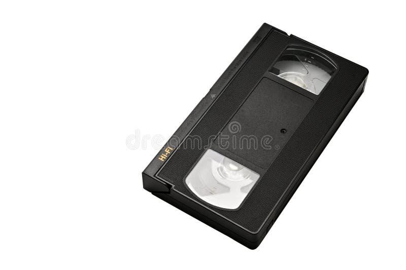 Videoband f?r hem- bruk p? en vit bakgrund videocassette arkivbilder