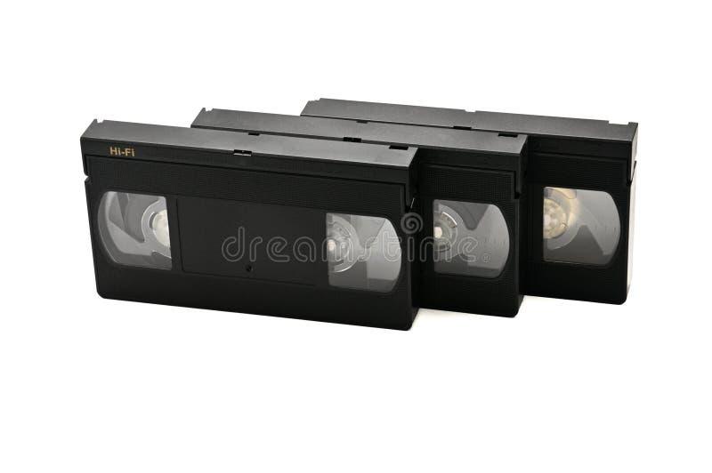 Videoband f?r hem- bruk p? en vit bakgrund videocassette arkivfoto