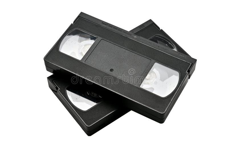 Videoband f?r hem- bruk p? en vit bakgrund videocassette arkivfoton