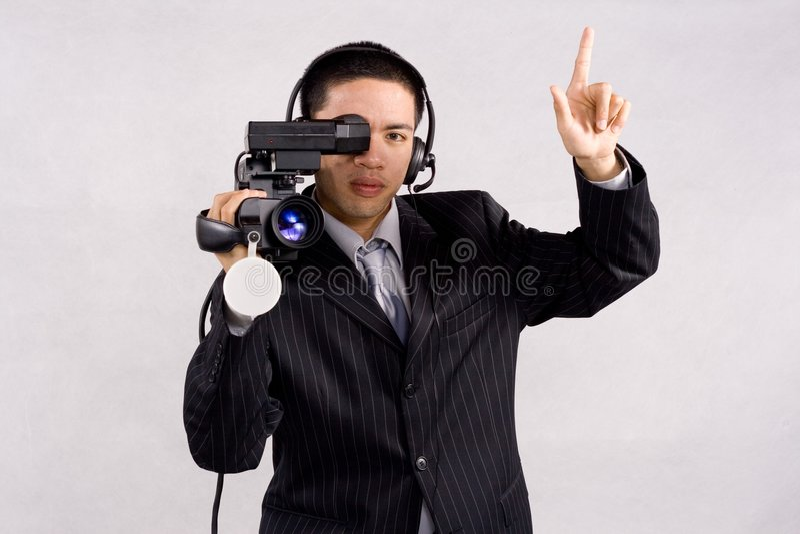 Videocamera high definition. Cameraman using a high definition video camera stock photos
