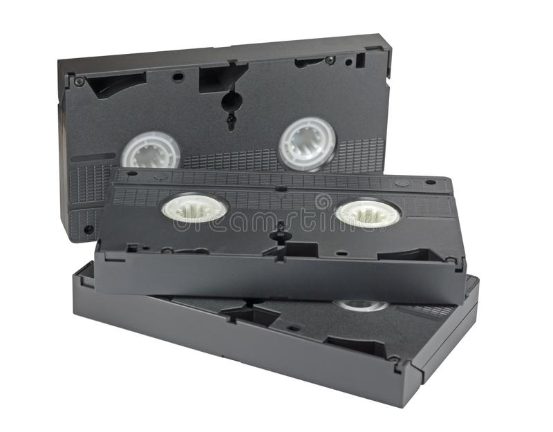 Videocassettes op wit stock afbeelding
