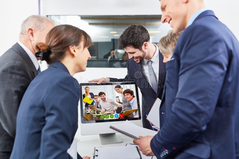 Videoconferência da equipe do negócio imagem de stock