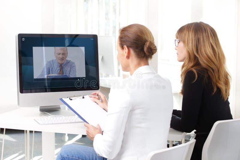 Videoconferentievergadering royalty-vrije stock foto's