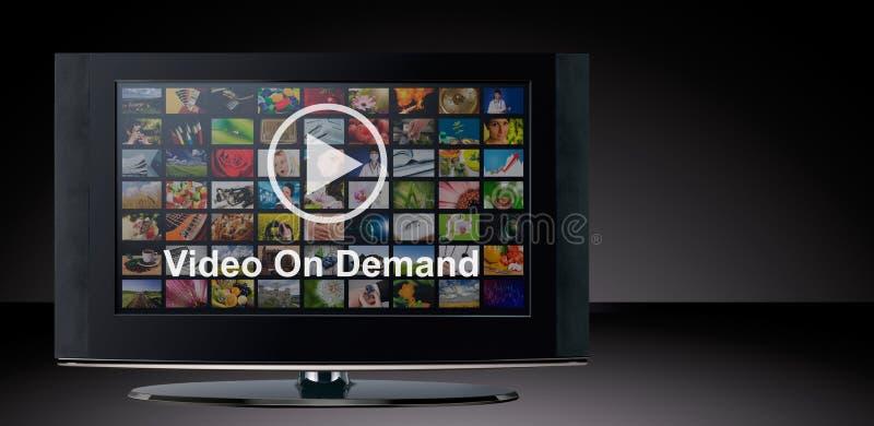 Videoen på - begära VOD service på TV royaltyfri fotografi