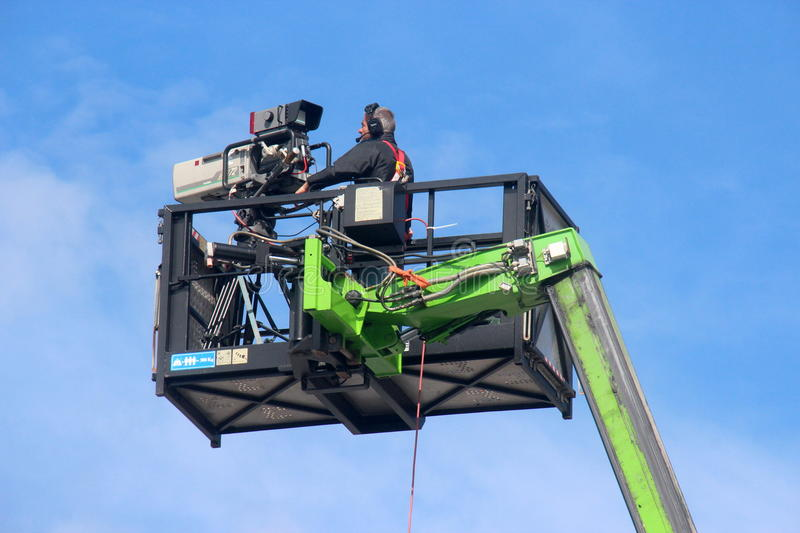 Download Videographer On Crane Basket Editorial Image - Image of voltri, container: 42982795