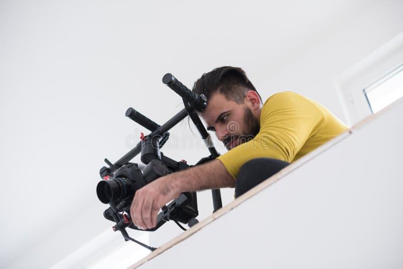 Videographer en el trabajo fotografía de archivo