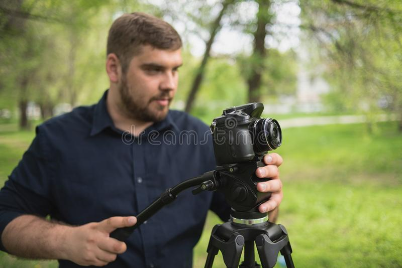Videographer shoots video in a green park royalty free stock photos