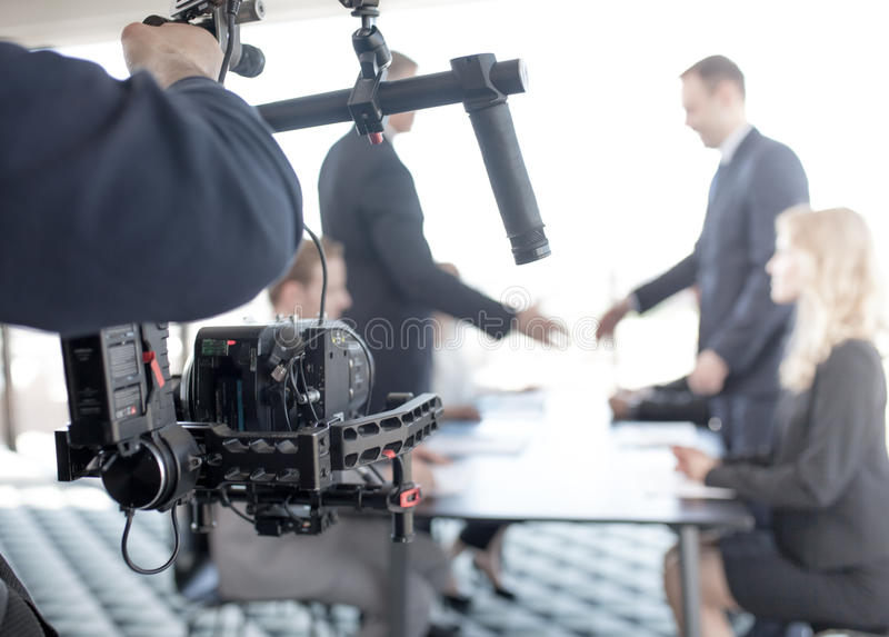 Videographer making video of business people royalty free stock photography