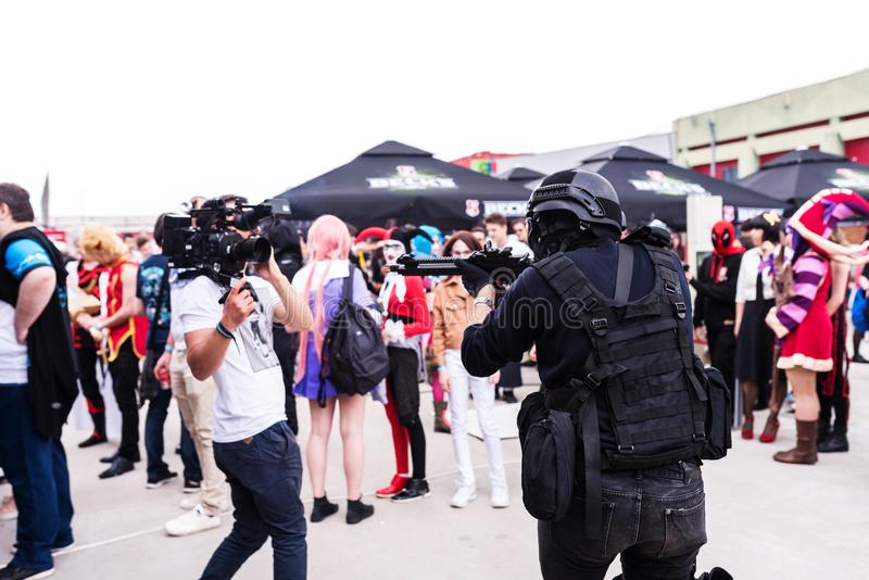 Videographer making a video with gunmen cosplayers. At East European Comic Con, 2017, in Bucharest, Romania stock photography