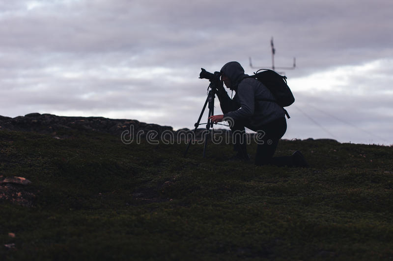 Videographer Photographer Works in the Mountains royalty free stock photography
