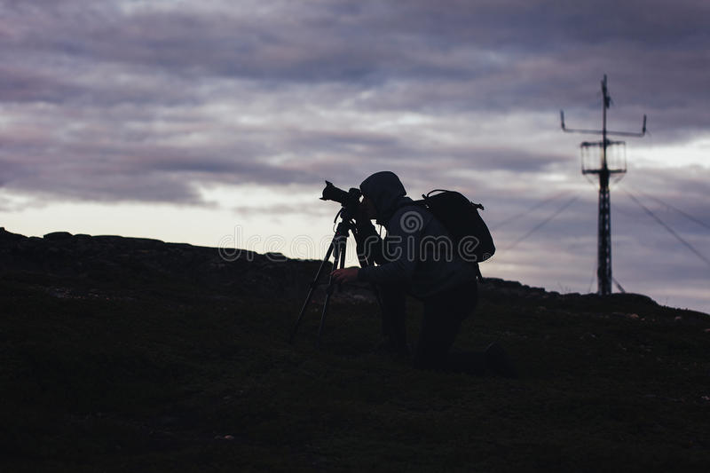 Videographer Photographer Works in the Mountains royalty free stock photo