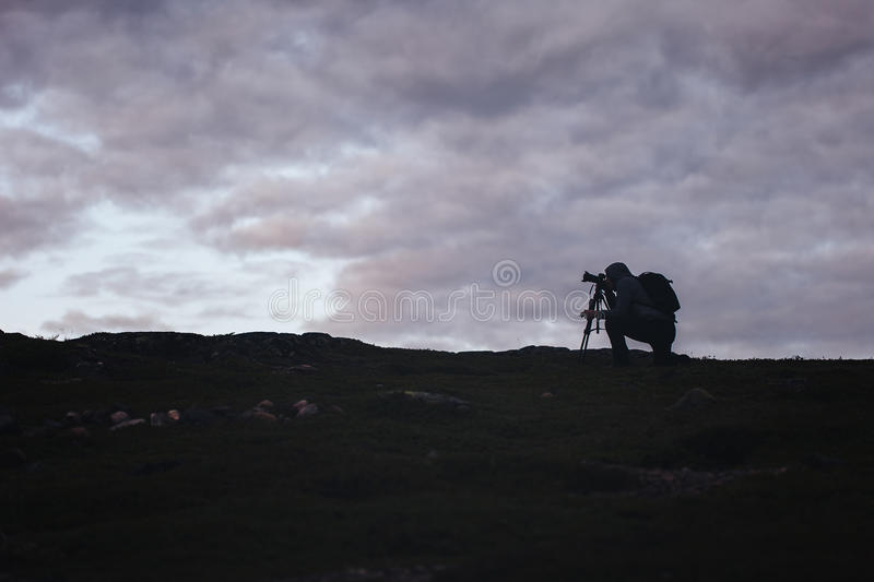 Videographer Photographer Works in the Mountains royalty free stock images