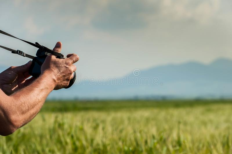 Videographer shooting handheld videos outdoor on the wheat field at sunset stock photos