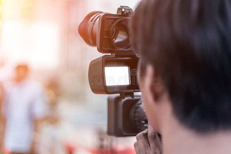 Videographer takes video camera royalty free stock image