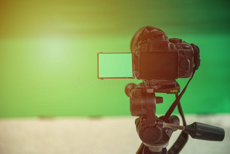 Videographer taking video camera, camera equipment film stand by on green screen royalty free stock photography