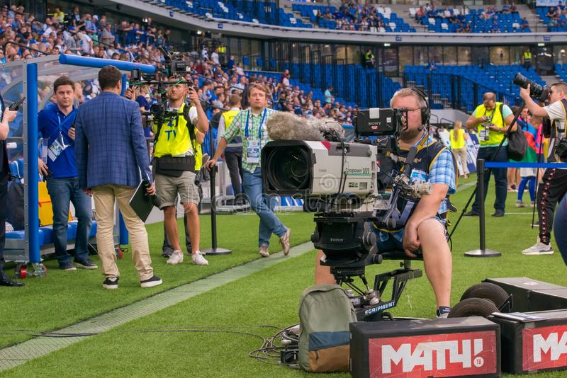 Videographer at work during the soccer game stock photos