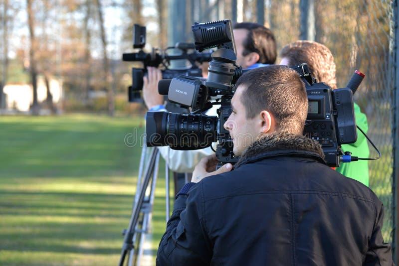 Videographers sorveglia l'addestramento fotografia stock libera da diritti