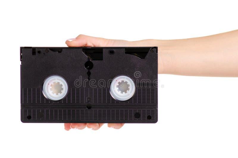 Videokassett i hand arkivbild
