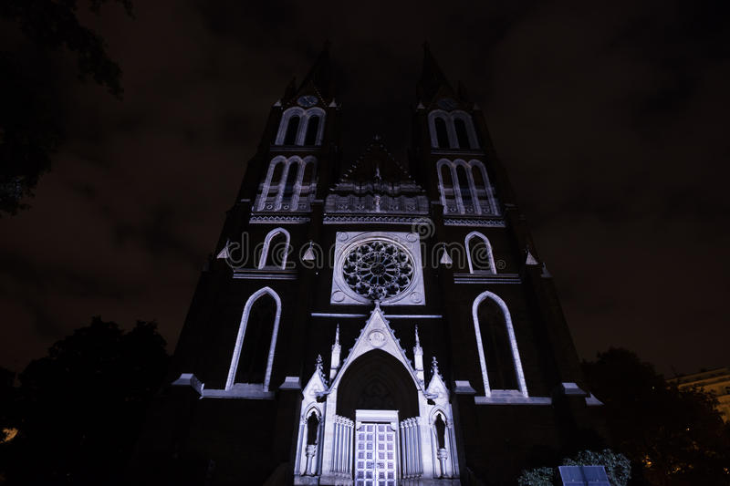 Videomapping Point Line Surface Solid by Daniel Rossa at Saint Ludmila churs at the Prague Signal light festival 2016. PRAGUE, CZ - OCTOBER 15, 2016 stock image
