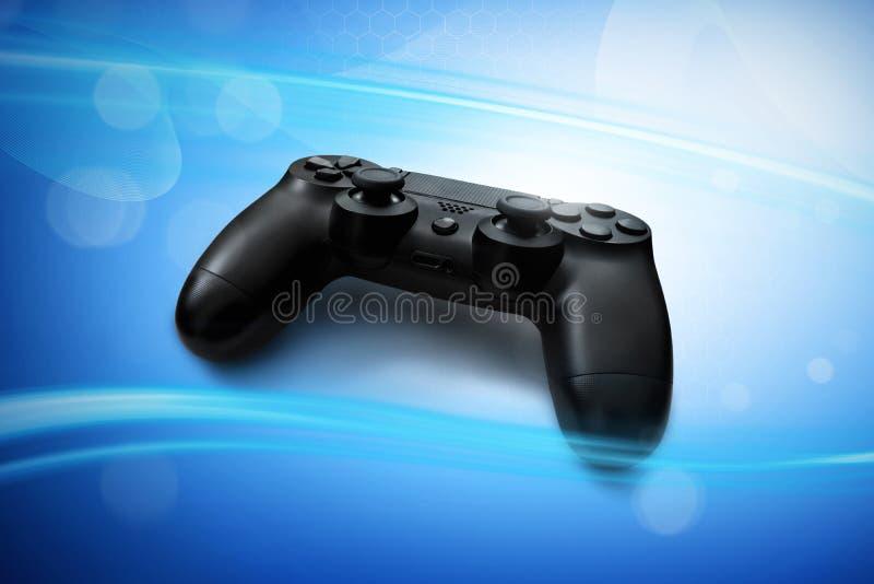 Videospelkontrollant på blå bakgrund royaltyfri fotografi