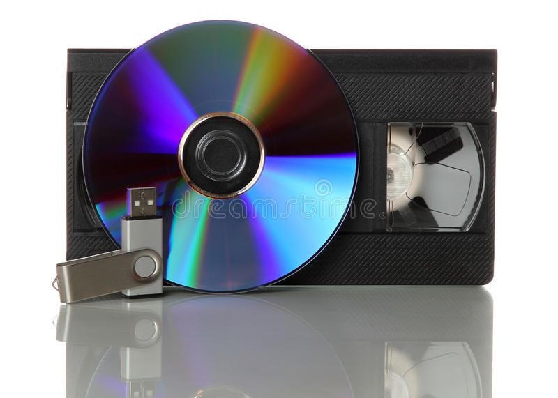 Videotape with cd and usb stick. On white background stock photo