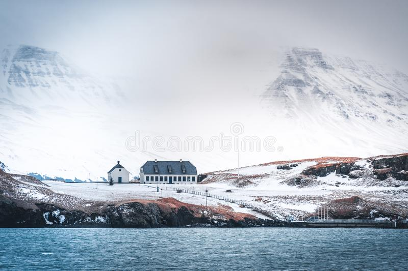 Videy and Esjan in Reykjavik, Iceland with snow covered mountains and yellow orange meadows. royalty free stock images