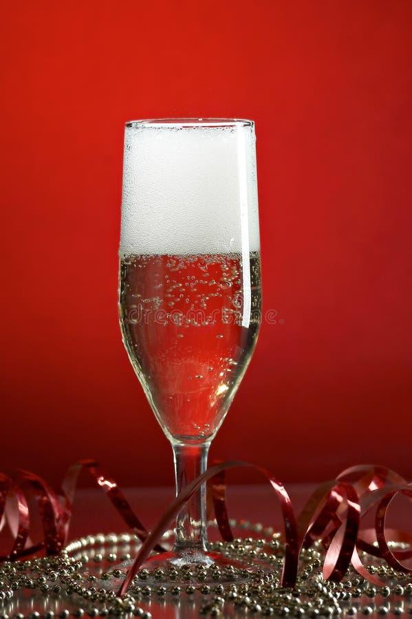 Vidrio con champán foto de archivo libre de regalías