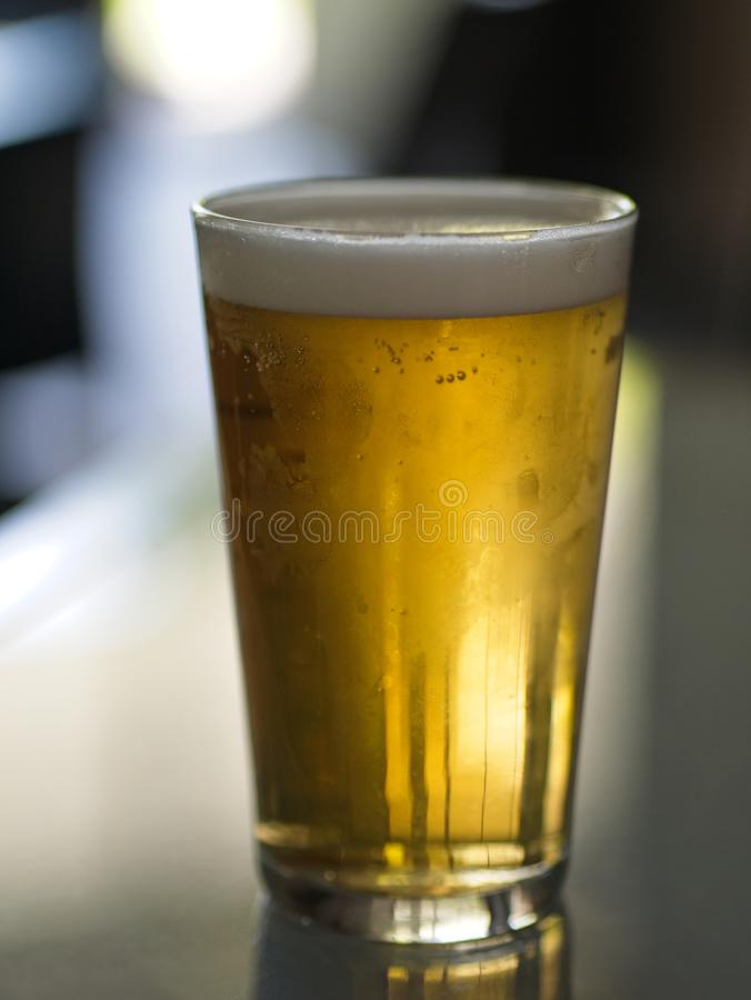Vidrio de Lager Beer frío en una tabla imagen de archivo libre de regalías