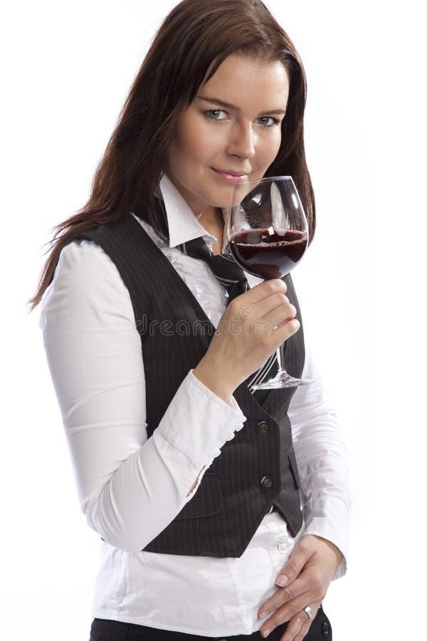 Vidrio de vino de la explotación agrícola de la mujer de negocios fotografía de archivo
