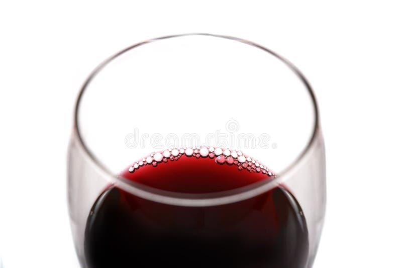 Vidrio de vino rojo con las burbujas imagen de archivo