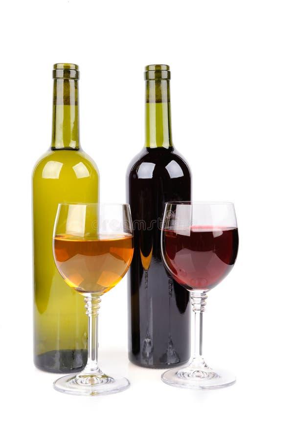 Vidrio de vino y botella de vino imagen de archivo libre de regalías