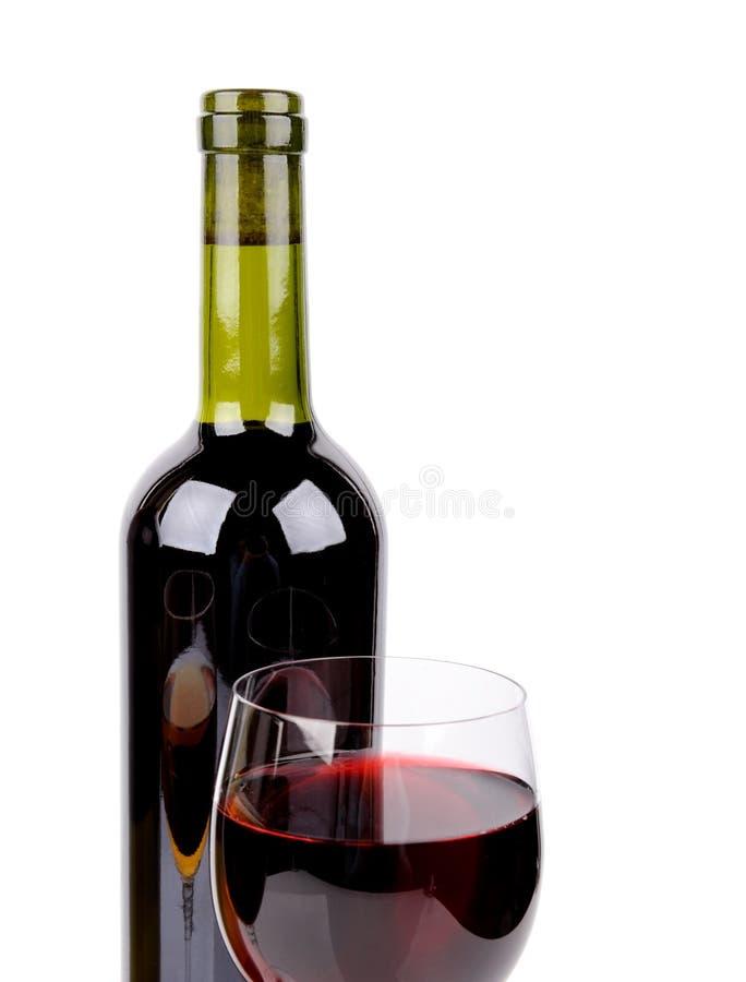 Vidrio de vino y botella de vino fotos de archivo libres de regalías