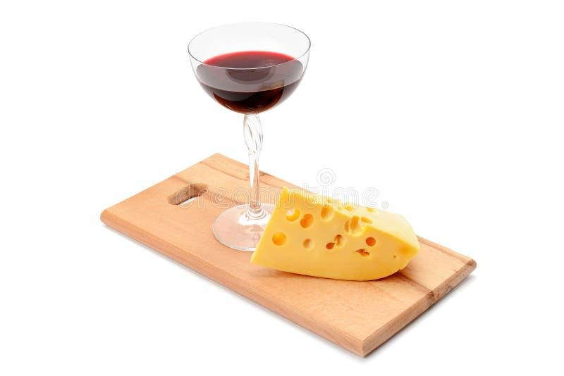 Vidrio de vino y de queso imagen de archivo libre de regalías