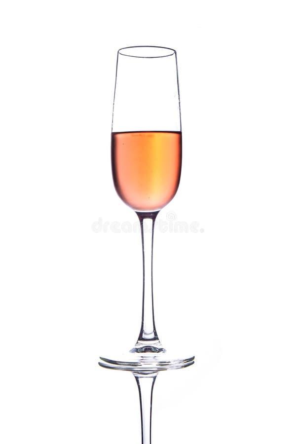 Vidrio del champán del rosa de Rose con las burbujas aisladas en el fondo blanco fotos de archivo