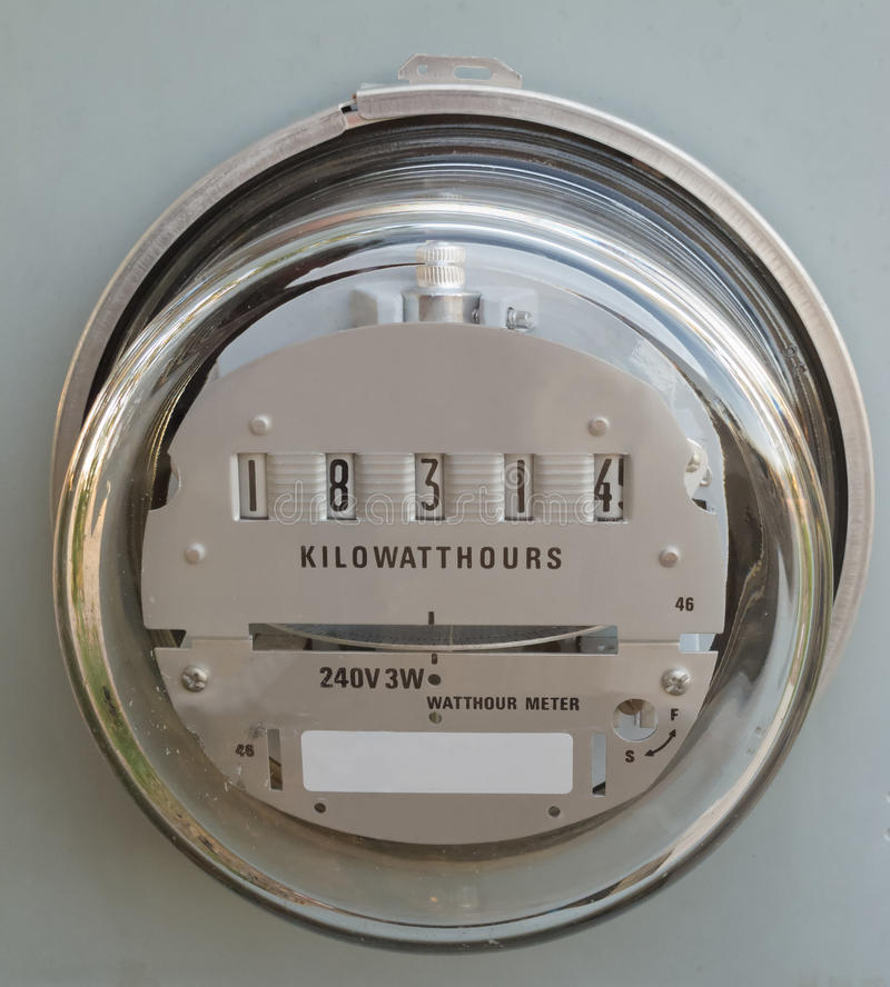 Vidrio del metro del vatio-hora de la fuente de energía eléctrica cubierto foto de archivo
