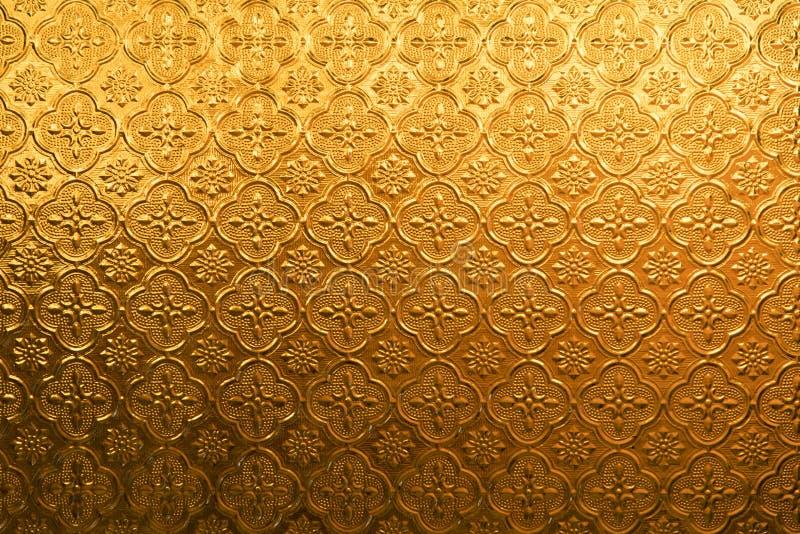 Vidrio del vintage de la flor del oro amarillo para la textura y el fondo abstractos imagenes de archivo