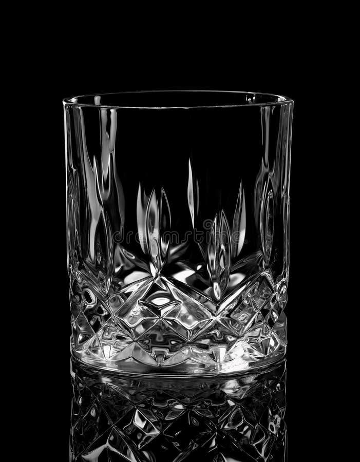 Vidrio del whisky en negro fotografía de archivo