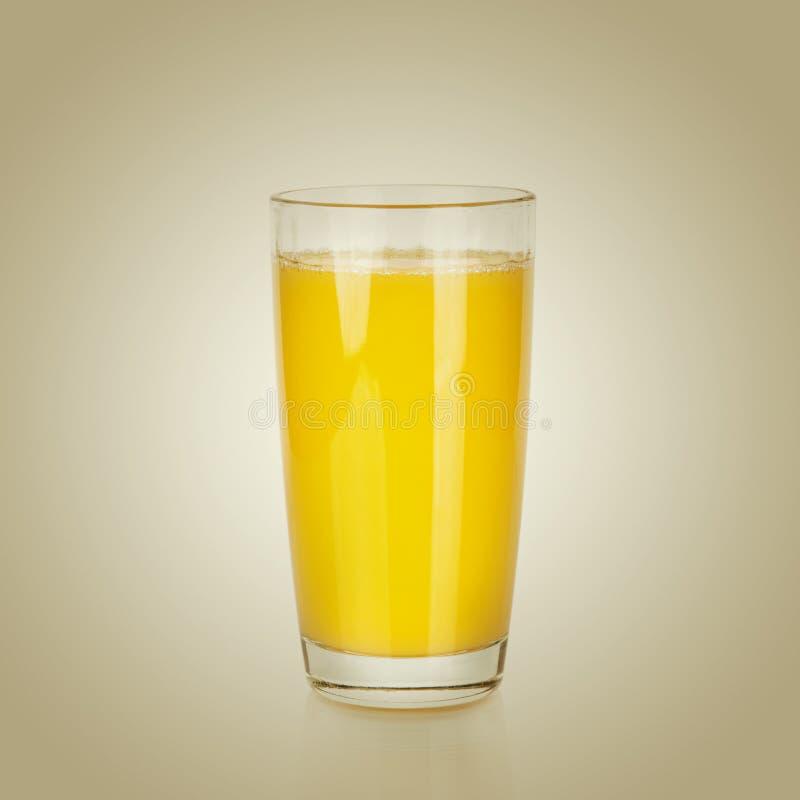Vidrio lleno de zumo de naranja imagen de archivo