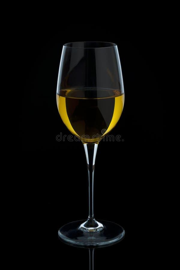 Vidrio móvil de vino blanco imagenes de archivo