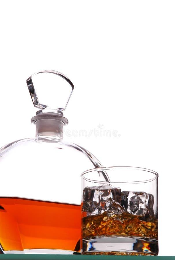 Vidrio y jarra del whisky imagen de archivo