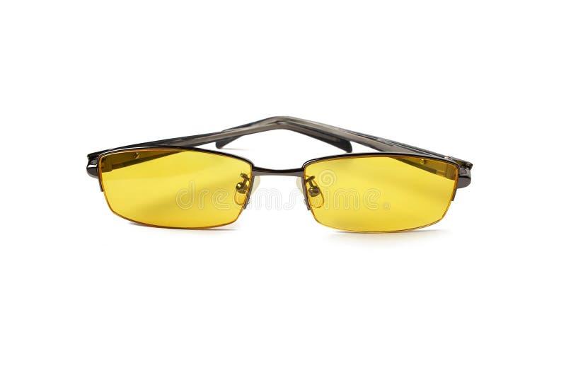 Vidrios con las lentes amarillas Gafas de los vidrios de noche para los conductores de coche Aislado fotografía de archivo