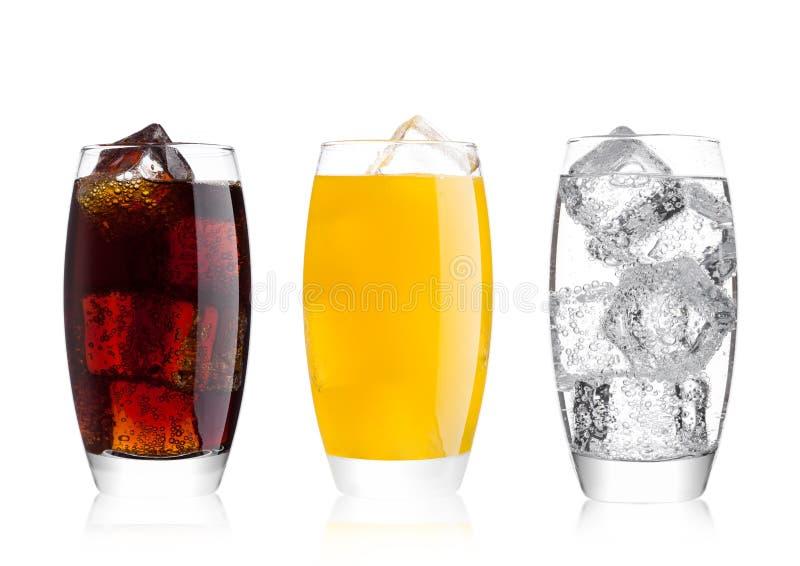 Vidrios de cola y de bebida y de limonada de la soda anaranjada fotografía de archivo