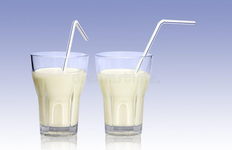 Vidrios de leche imagen de archivo libre de regalías