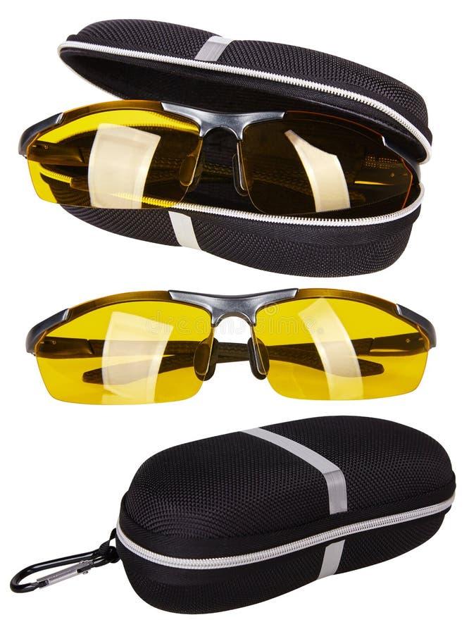 Vidrios de moda con las lentes amarillas Desgaste del ojo de vidrios de noche para los conductores de coche Aislado en blanco imagen de archivo libre de regalías