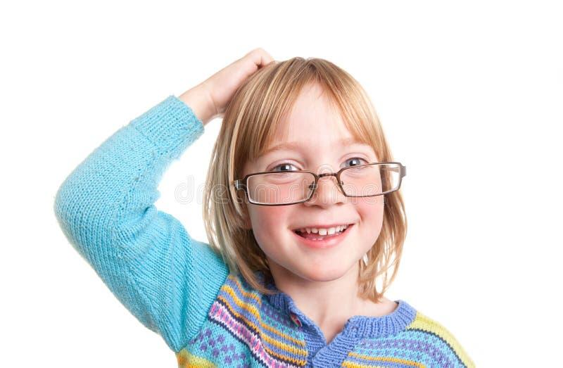 Vidrios de pensamiento del niño imagen de archivo