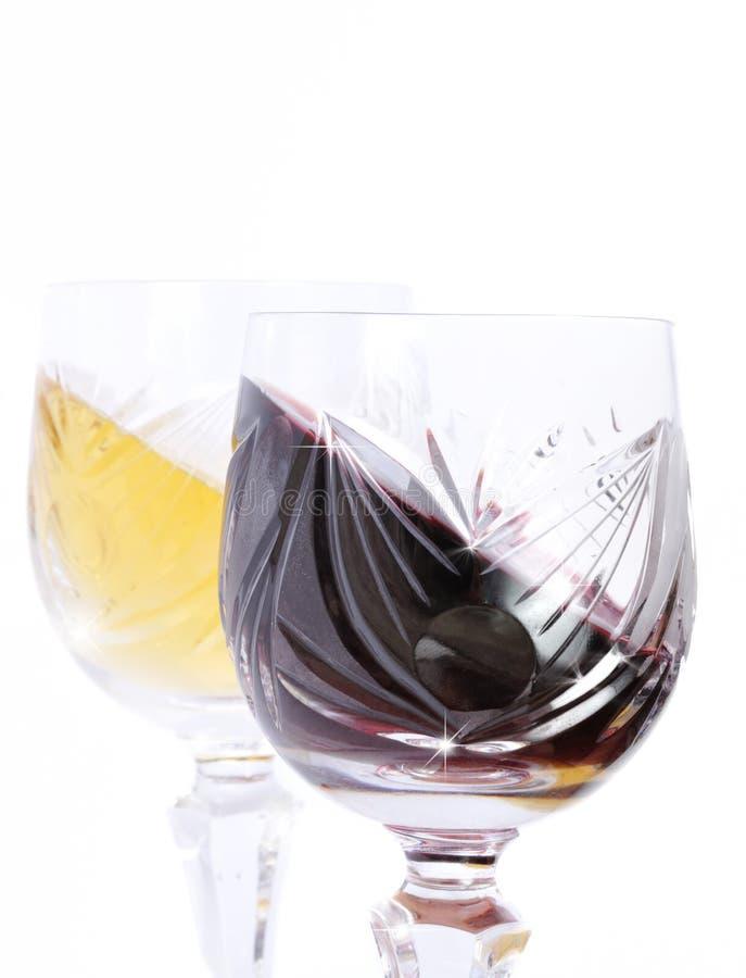 Vidrios de vino blanco rojo y fotos de archivo