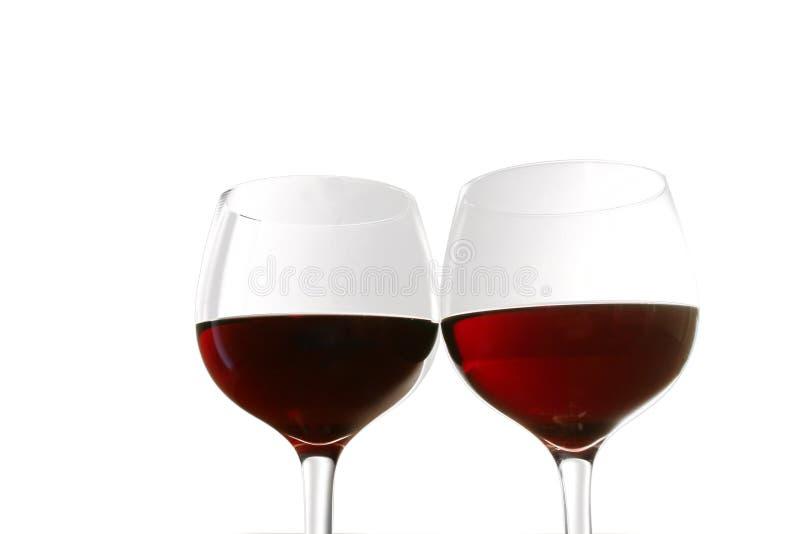Vidrios de vino rojo foto de archivo libre de regalías